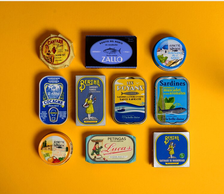 Blue fish tins on yellow background