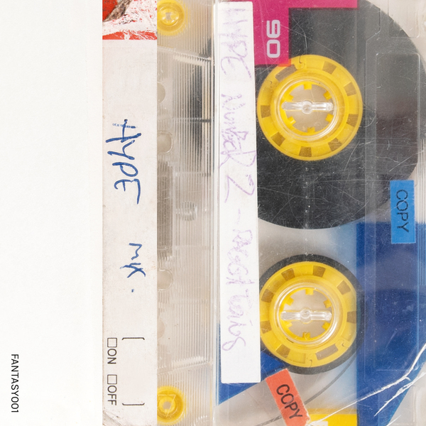 close up of cassette tape with yellow centers