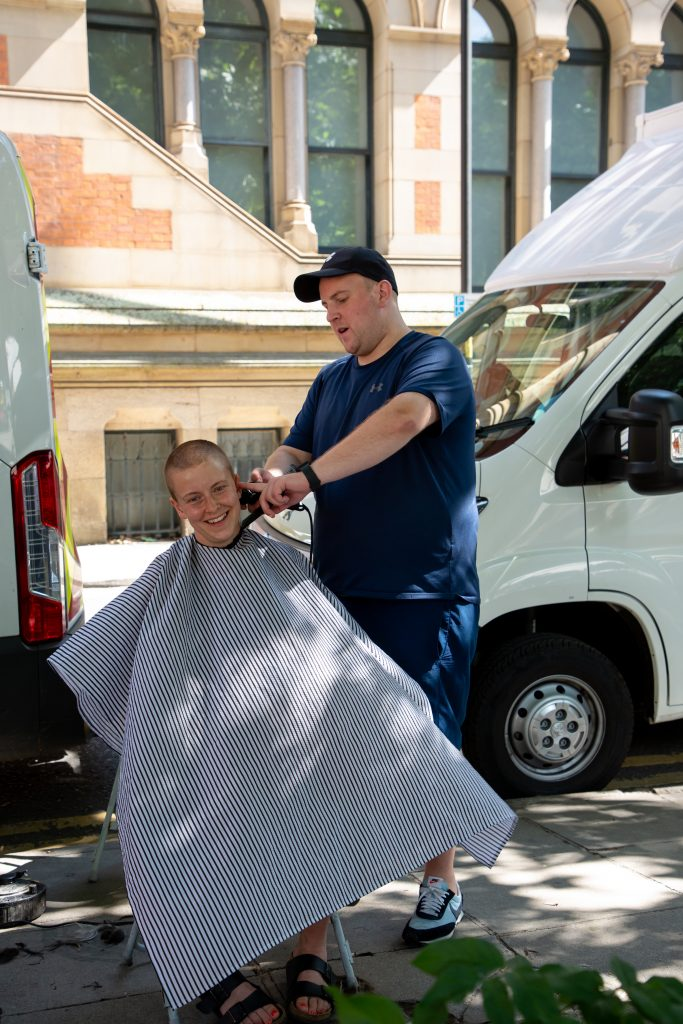Dean the Barber cutting Alice from MCC's hair